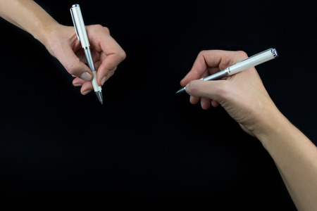 Hand holding pencil, set isolated on black background Stock Photo