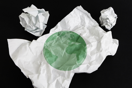 Crumpled paper sheet with Earth illustrated on it, isolated Stock Photo