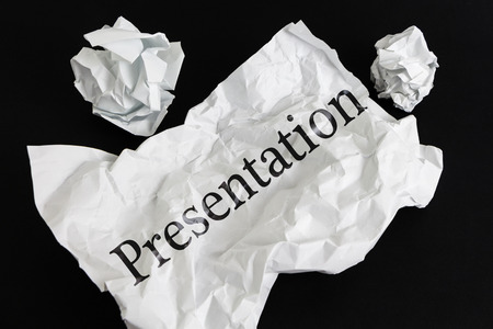Crumpled paper sheet with word Presentation isolated on black Stock Photo