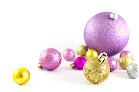 Various sized and colored Christmas balls isolated on white