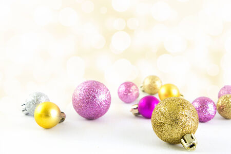 Various sized and colored Christmas balls with bokeh background Stock Photo