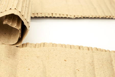 torn cardboard: Torn cardboard sheet with place for text isolated on white Stock Photo
