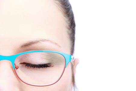 Female face closeup on closed eye with glasses isolated on white background