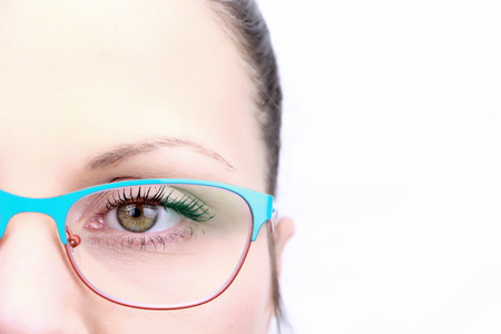 Female face closeup on eye with glasses isolated on white background