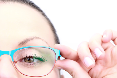 Female holding her glasses and looking straight closeup on white Stock Photo