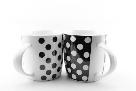 Black and white polka dots mugs isolated on white background photo