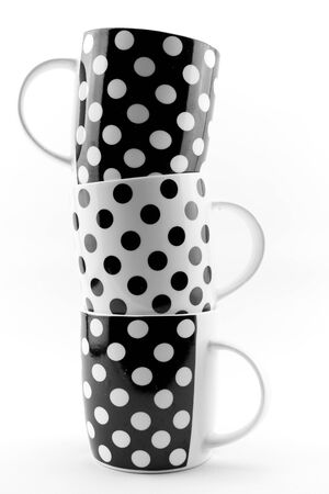 coffee and tea: Black and white polka dots mugs isolated on white background Stock Photo