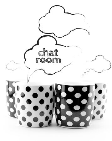 chit chat: Coffee mugs with speech bubbles Chat room text  isolated on white Stock Photo