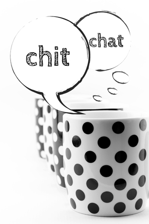 chit chat: Coffee mugs with speech bubbles Chit chat isolated on white background