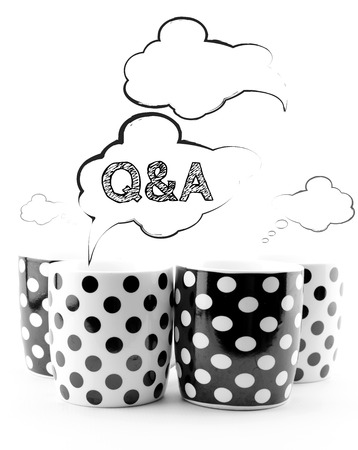 Coffee mugs with speech bubbles Q&A isolated on white background