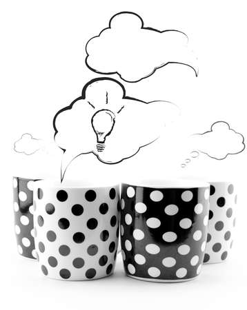Coffee mugs with speech bubbles and light bulb isolated on white Stock Photo