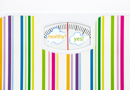 Bathroom scale with text bubbles on dial, with lines no numbers Stock Photo