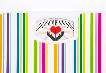 Bathroom scale with heart on dial with lines no numbers Stock Photo