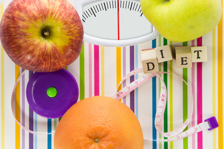 Bathroom scale with fruits and diet text on dial with lines no numbers Stock Photo