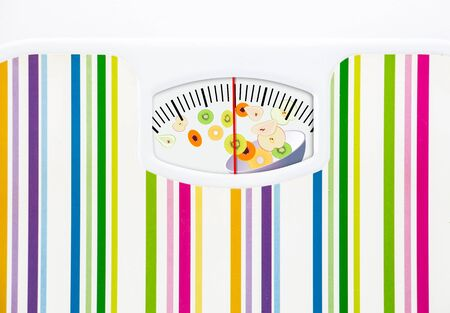 anorexia: Bathroom scale with bowl of fruits on dial with lines no numbers Stock Photo