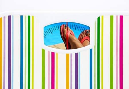 Summer diet concept with bathroom scale and swimming pool on dial Stock Photo