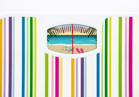 Summer diet concept with bathroom scale and beach on the dial Stock Photo