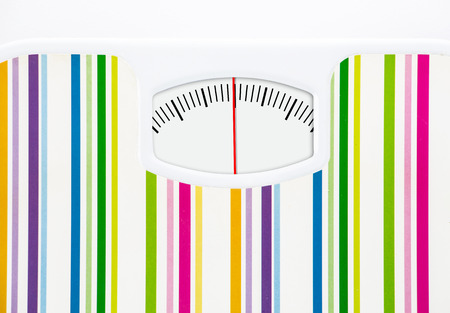 Bathroom scale with clean dial with lines no numbers on white