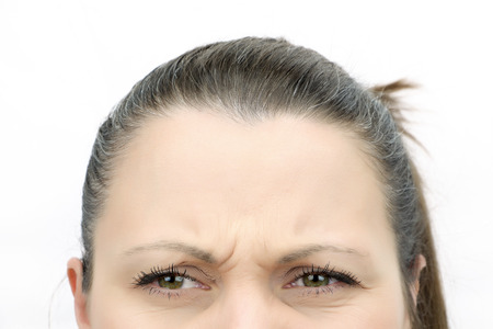 Top of female face looking frown isolated on white