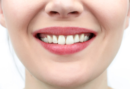 mouth opened: Closeup on mouth of females smiling face Stock Photo