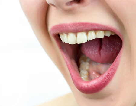 Closeup on mouth of females face, shouting