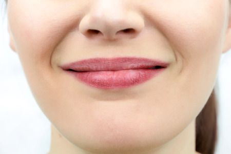 Closeup on mouth of females smiling face Stock Photo