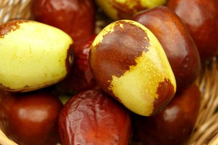 national fruit of china: Jujube fruits in wicker basket closeup