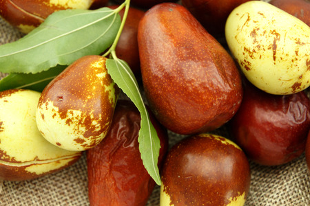 national fruit of china: Jujube fruits with leaves closeup Stock Photo