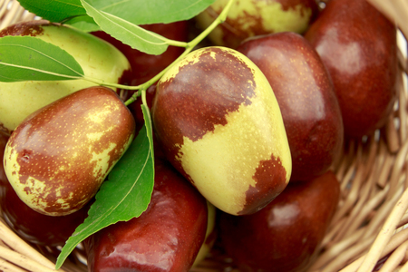 national fruit of china: Jujube fruits in wicker basket closeup