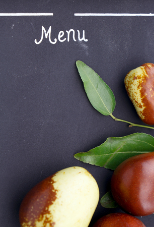 national fruit of china: Jujube fruit closeup on blackboard menu Stock Photo