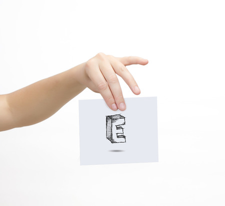e ink: Hand holding a piece of paper with sketchy capital letter E, isolated on white. Stock Photo