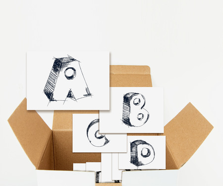 sketchy: Sketchy capital letters on cards in box, isolated on white. Stock Photo