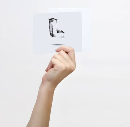 l hand: Hand holding a piece of paper with sketchy capital letter  L, isolated on white.