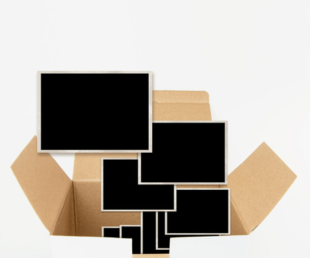 old photograph: Opened carton box with old photograph templates, isolated on white.