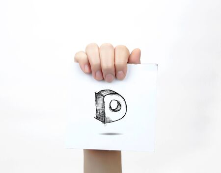 drawing paper: Hand holding a piece of paper with sketchy capital letter D, isolated on white.