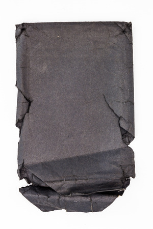 old envelope: Black old torn paper envelope,  isolated on white background. Stock Photo