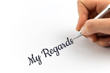 regards: Hand writing My Regards on white sheet of paper. Stock Photo