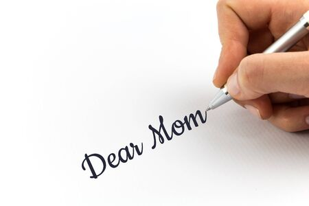 my dear: Hand writing Dear Mom on white sheet of paper.