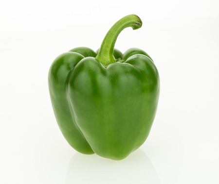 Fresh green bell pepper, isolated on white background.