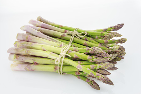 raffia: Two bunches of asparagus tied with raffia cord, isolated on white background. Stock Photo