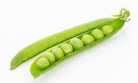 pea pod: Fresh green pea pod closeup, isolated on white background Stock Photo