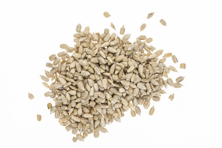 hulled: Heap of hulled sunflower seeds, on white background Stock Photo