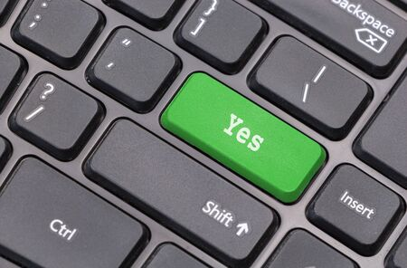 affirmative: Computer keyboard closeup with Yes text on green enter key Stock Photo