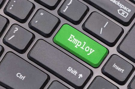employ: Computer keyboard closeup with Employ text on green enter key Stock Photo