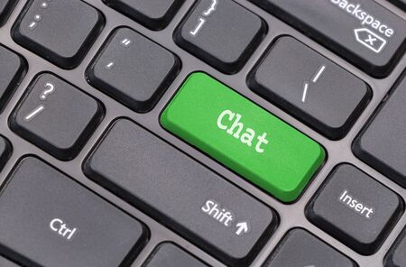 chat room: Computer keyboard closeup with Chat text on green enter key