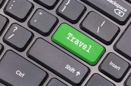 enter key: Computer keyboard closeup with Travel text on green enter key Stock Photo