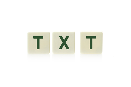 txt: Word TXT on board game square plastic tile pieces, isolated on a white background.