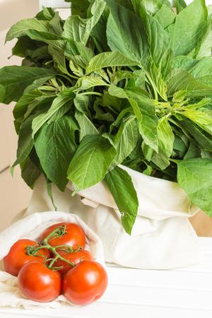 amaranthus: Fresh tomatoes and amaranthus blitum in eco cloth bags.