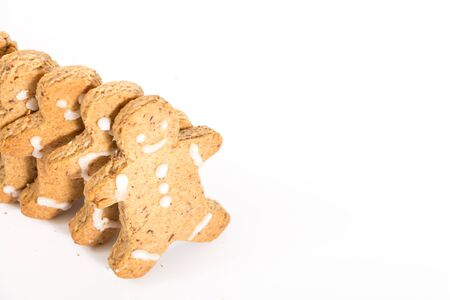 Gingerbread men cookies, on white background with copy-space.