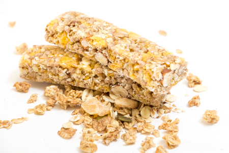 Granola energy bars with nuts and dry fruits, on white background. Stock Photo
